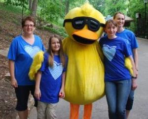 Anette and Nadia, local Cultural Care Au Pair respresentatives, with Courtney and her family's German au pair Tanja, posing with Duck.